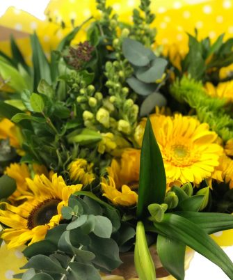 Snapdragons, St Joseph Lilies, Penny gum, Sunflowers, Gerberas, Lime Sprays, Chrysanthemums, Tulips, Viburnum leaves and Lime Anthuriums